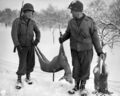 US soldiers after a successful hunting day in early 1945.png