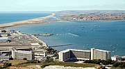 The western side of the Harbour with Chesil Beach, Lyme Bay and the Fleet Lagoon in the background