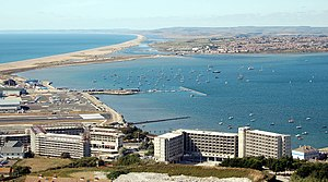 Portland Harbour - The western side of the Harbour with Chesil Beach, Lyme Bay and the Fleet Lagoon in the background.
