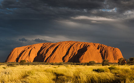 Uluru (Ayers Rock) is a large sandstone formation in Northern Territory, Australia. Uluru (Ayers Rock), Sunset.jpg