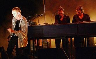"Underworld (band) - Underworld performing ""Jumbo"" in Central Park, New York City, 2007."