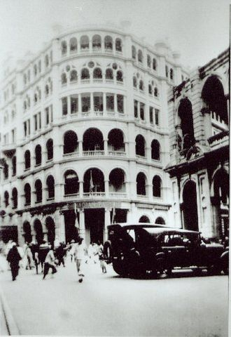 Chater House - Union Building viewed from Pedder Street, looking north, c.1926. A corner of the burnt down Hong Kong Hotel is visible on the right.