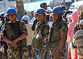 United Nations Peacekeepers from Nepal provide security at a rice distribution site in Kenscoff, Haiti, Feb. 20, 2010 100220-N-HX866-006.jpg