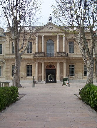 Entrance to the main university building. This 18th century portico was once the entrance to the Hopital Sainte-Marthe. UniversiteAvignon-Entree.jpg
