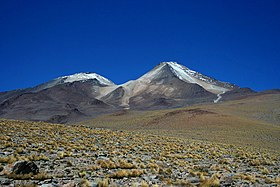 Uturunku is a cone in a desolate landscape, with an adjacent smaller non-conical mountain.