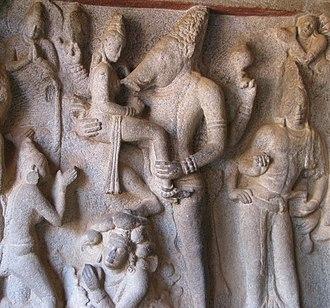 Varaha - A rare left-facing Varaha holding Bhudevi, 7th century CE, Mahabalipuram.