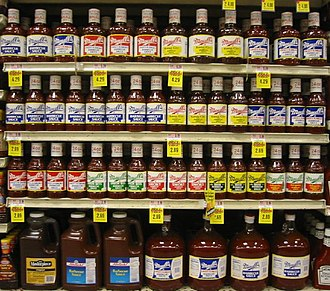 Maull's barbecue sauce - Common large shelf display of Maull's BBQ sauces at a St. Louis grocery store