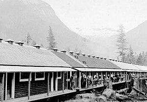 MacMillan Bloedel - Exterior of workers' huts at 120 man logging camp, Kingcome River