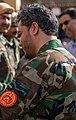 Yasin Zia greeting troops (cropped).jpg