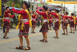 Dance and theatre of Laos - A folk dance in the Rocket Festival parade in Yasothorn, Thailand. The Lao of Isan have preserved Lao cultural traditions, including morlam and folk music.