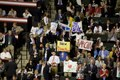 Young people hold up signs supporting McCain while Republicans gather to listen to speeches at the Republican National Convention, September 1-4, 2008, Xcel Center, St. Paul, Minnesota LCCN2010719290.tif