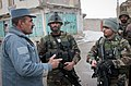 (From left) Afghan Uniformed Police(AUP) Senior Capt. Abdul Kardur, Afghan National Army(ANA) 1st Sgt. Shir Baharar, and ANA 1st Lt. Ali Ahmad discuss the successful detonation of an improvised explosive device 120218-A-ZU930-004.jpg