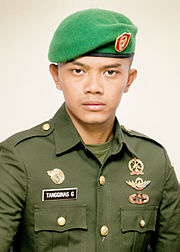 An Indonesian Army soldier wearing a green beret with general Army insignia 407ddb1eb03