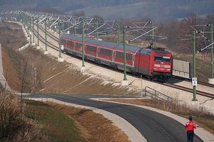 DB Class 101 - 101 029 in front of a regional train on Nuremberg–Ingolstadt high-speed rail line.
