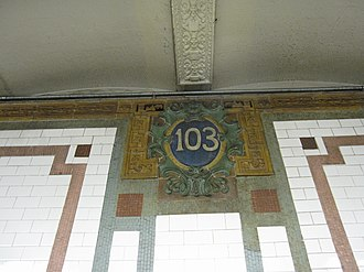 103rd Street (IRT Broadway–Seventh Avenue Line) - Cartouche by Grueby