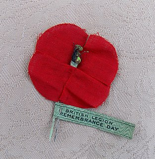 Remembrance poppy artificial flower worn to commemorate military personnel who have died during war