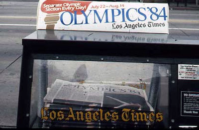 Newspaper vending machine announcing the 1984 Olympics. 1984-Newspaper-Vending-Machine.jpg
