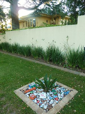 Houghton Estate - Mandela Mansion, Houghton Estate, Johannesburg, 2014. Well-wishing mementos have been left in the foreground.