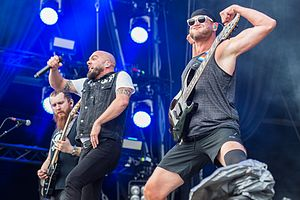 Adam Dutkiewicz - Adam Dutkiewicz (far right) performing in Killswitch Engage. Adam Dutkiewicz is well known for his unique stage attire.