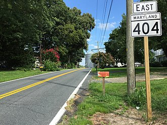 Maryland Route 404 - MD 404 running east through Wye Mills at its western terminus at MD 662