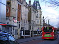 308 bus passing the Library and former council chamber, Leyton January 2014 (12162549006).jpg