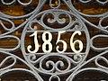Año 1856, en la puerta de la casa número 2, de la calle Espoz y Mina, esquina Puerta del Sol, de Madrid, España.JPG