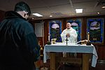 A Navy chaplain performs roman catholic mass in the ship's chapel aboard USS Ronald Reagan. (31951846852).jpg