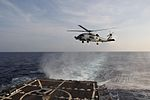 A U.S. Navy MH-60S Seahawk helicopter assigned to Helicopter Maritime Strike Squadron (HSM-78) approaches to land aboard the guided missile destroyer USS Pinckney (DDG 91) March 9, 2014, in the Gulf of Thailand 140309-N-ZZ999-001.jpg