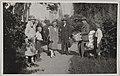 Akseli Gallen-Kallela (holding a basket) in a company at architect Jarl Eklund´s villa, 1926. (14725548811).jpg