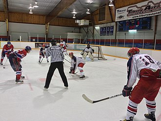 Great Lakes Junior C Hockey League - Alvinston Flyers lining up for a face-off in the defensive zone at the Belle River Canadiens' 2013 home opener.
