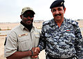 American contractor Mr. Brown greets an instructor at the Iraqi police academy in Basrah 110420-A-YD132-143.jpg