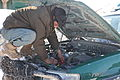 An Afghan Uniform Police (AUP) officer works on an AUP vehicle Feb 120213-A-BZ540-033.jpg