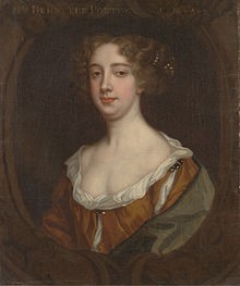 Aphra Behn, 17th century lady in a low cut russet colour gown.