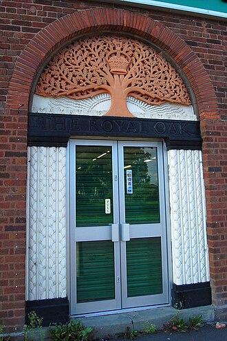 Lozells - Doorway of The Royal Oak, carving by William Bloye.