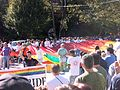 Atlanta Pride 2009 parade - large rainbow flag with crowd.jpg