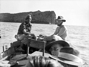 Berhala Island, Sabah - Jock McLaren, one of the POWs who escaped from Berhala Island in World War II, returning there after the war. The high cliffs of the northern end of the island are visible.