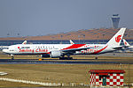 B-2035 - Air China - Boeing 777-39L(ER) - Smiling China Livery - PEK (13993392582).jpg