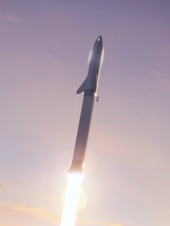 The BFR launch vehicle, with its Super Heavy first stage and Starship upper stage, during flight to orbit