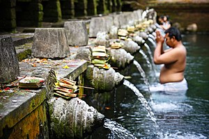 Balinese people come to bathe in the sacred waters; August 2009.jpg