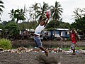 Bana, a Junior player for the China Town AFL team takes a leaping catch at football training at the Lord Howe settlement, Honiara. (10676737796).jpg