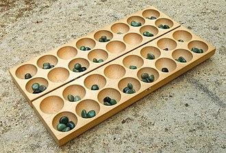 Omweso - A modern, European board with jade gemstones