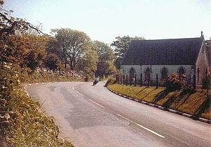 Barregarrow - TT rider Mick Grant just after the crossroads passing the chapel on his descent of the hill during the Formula 1 TT in 1985