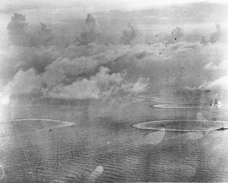 Philippine Sea - Japanese Carrier Division Three under attack by United States Navy aircraft from Task Force 58, late afternoon, June 20, 1944. The heavy cruiser circling at right, nearest to the camera, is either Maya or Chōkai. Beyond that, is the small aircraft carrier Chiyoda.