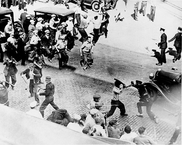 Teamsters, wielding pipes, clash with armed police in the streets of Minneapolis during a 1934 strike. Battle strike 1934.jpg
