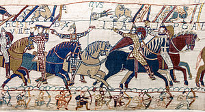 "Eustace II, Count of Boulogne - Supposed depiction of Eustace at the Battle of Hastings. Detail from Bayeux Tapestry. Inscription above Duke William: HIC EST WILLELMUS DUX (""Here is Duke William"") and above the figure to the right of him E...TIUS (apparently a Latinised form of ""Eustace"")"