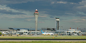 Beijing Capital International Airport - Ground view of Terminals 1 (foreground) and Terminal 2 (with blue roof, in background) in 2005. Terminal 2's air traffic control tower in the background has since been demolished