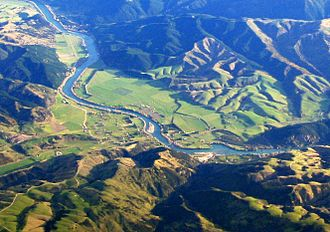 Otago - Aerial photo of Beaumont area in Otago, looking southwest. State Highway 8 runs from left to right across the photo (only visible in the right half), and crosses the Clutha River just below centre.