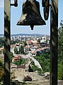 Bell with City Backdrop - Tsarevets Fortress - Veliko Tarnovo - Bulgaria (41409747640).jpg