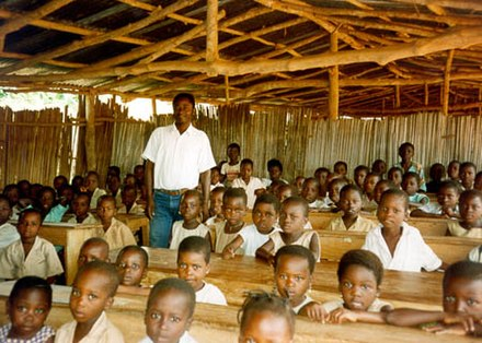 Teacher with students in a classroom in Benin. Benin classroom.jpg