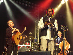 Benjamin Zephaniah - Collecting the Hancock at Cambridge Folk Festival 2008 with Martin Carthy looking on.